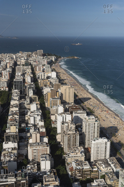 Aerial view from helicopter flight to city, ocean and mountains