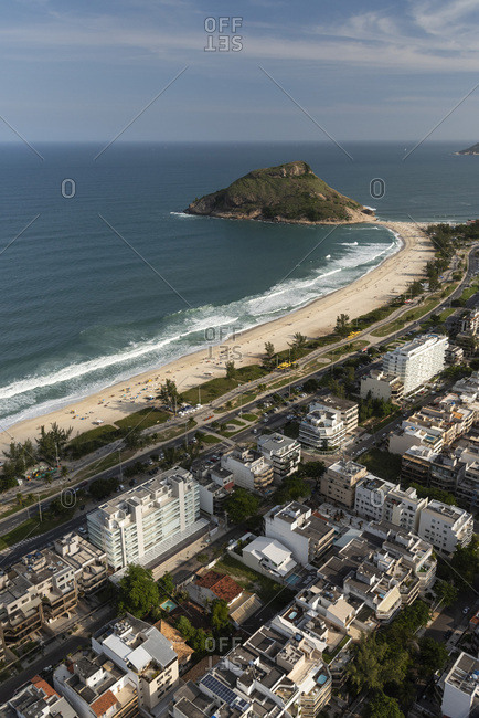 Aerial view from helicopter flight to ocean and the city
