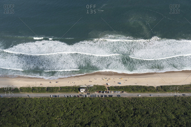Aerial view from helicopter flight to beautiful deserted beach