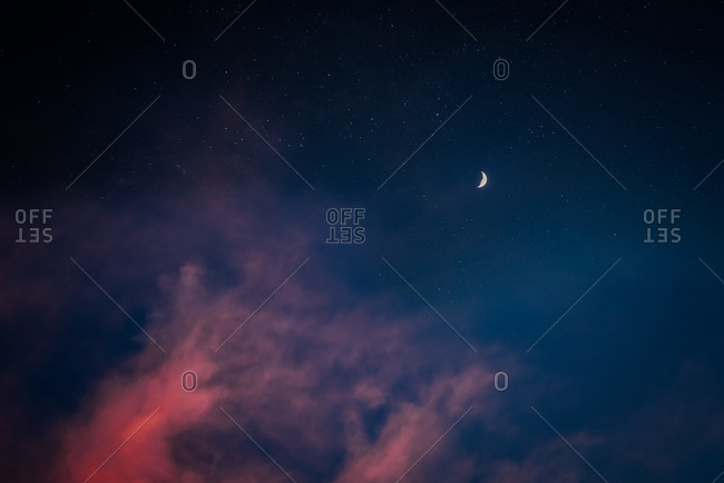 Night sky with stars and moon and clouds