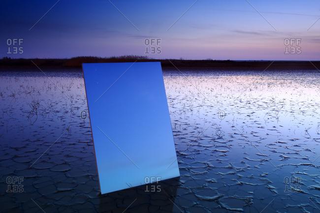 Reflection on a large crystal during the twilight in the natural park of las lagunas de villafafila. zamora. spain