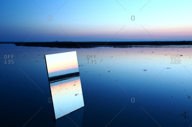 Reflection on a large crystal during the twilight in the natural park of las lagunas de villafafila. zamora. spain
