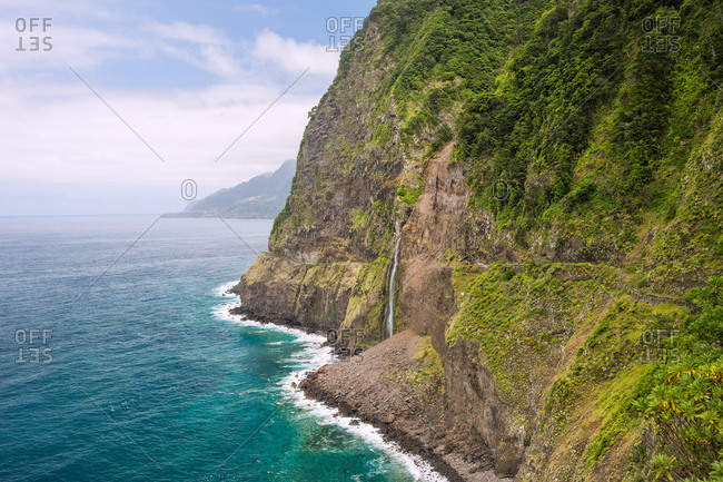 Waterfall landscape into the atlantic ocean in madeira, portugal
