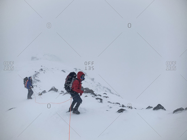 Mount Rainier National Park, Washington, United States - May 26, 2019: Climbers brave the elements as they descend to camp muir