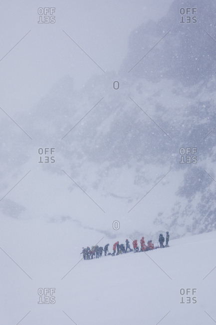 A group of climbers rests during a may blizzard on mount rainier