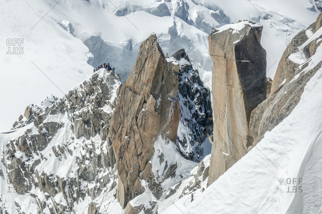 Mont blanc's famous cosmiques ridge on a sunny day, climber traffic
