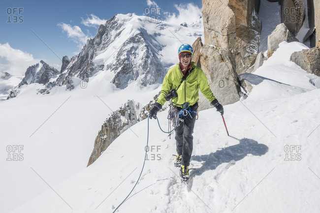 Smiling alpinist on easy ground on the famous cosmiques ridge