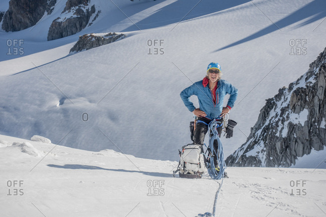 A seasoned alpinist takes a packs-off break high up in the alps