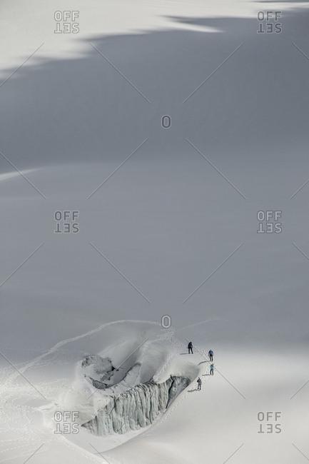 Four alpinists practice safe glacier techniques on le tour glacier