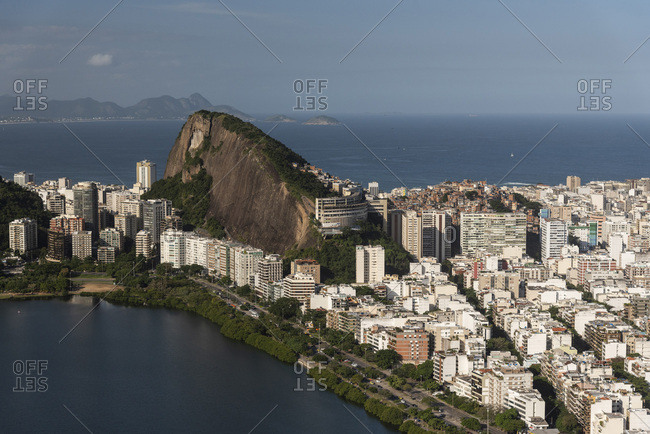 Rio de janeiro, brazil - june 22, 2019: aerial view from helicopter flight to city, ocean and mountains