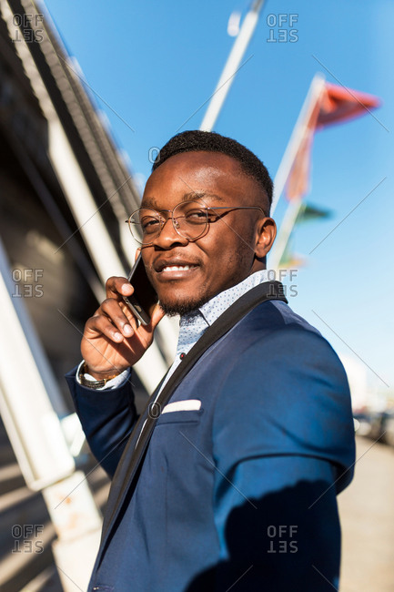 African american man with suit and sunglasses talking on phone