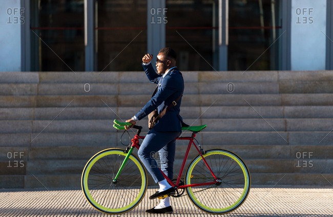 African american business man with bicycle cover his face by the sun