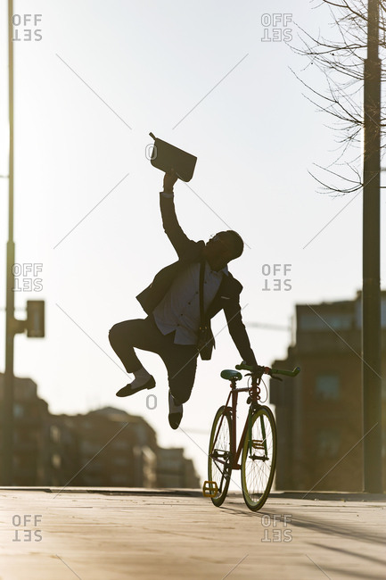 African american man walking by the city and jumping excited