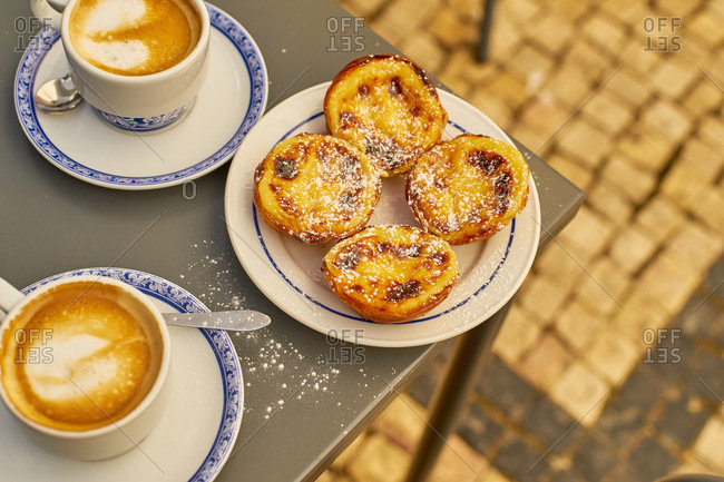 Classical pasteis de Belem shot in original cafe. Portuguese traditional sweets with custard cream and puff pastry.