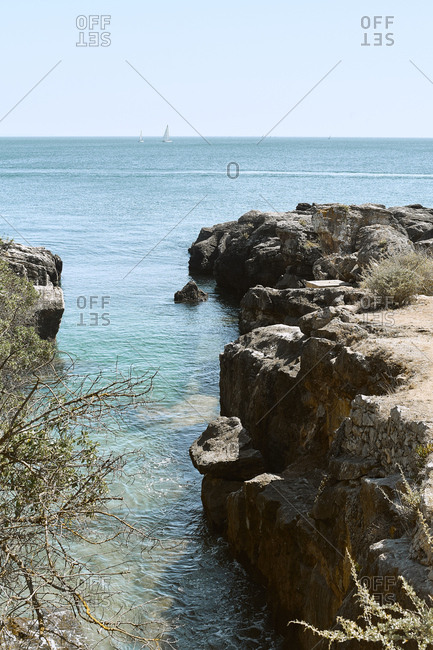Scenic view of the ocean cut through cliffs