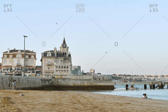 Cascais, Portugal - August 31, 2019: Tourists enjoying the beach and architecture