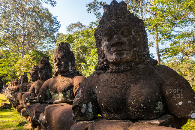 Statues at the entrance to Angkor Thom Cambodia