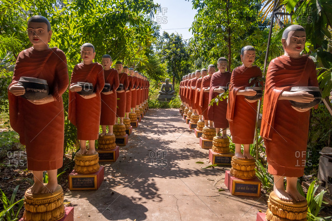 November 3, 2018: Row Of Buddhist Monk Statues In Cambodia Temple Siem Reap
