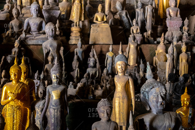 Collection of Buddha Statues Inside Pak Ou Caves, Luang Prabang In Laos