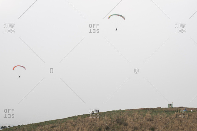 People paragliding on a climb