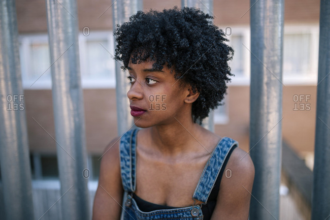 Black young woman with afro hair sitting pensive