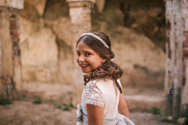 Girl of communion in an old convent in ruins.
