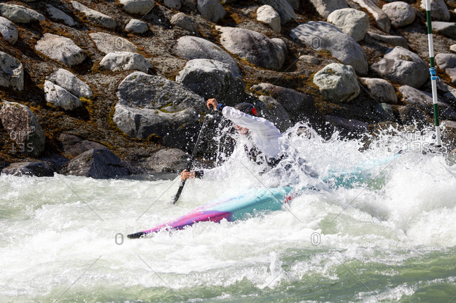 Olympic hopeful kayaker trains at the rutherford whitewater park.