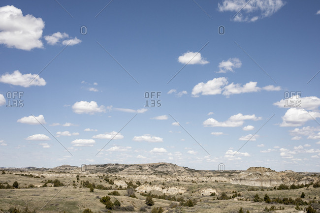 Rock formations stand prominent on the grasslands of north dakota.