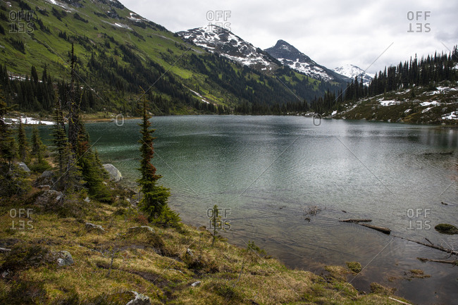 Scenic view of alpine lake in mountains with clouds in canada.