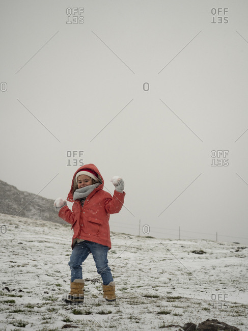 Little girl with snowballs