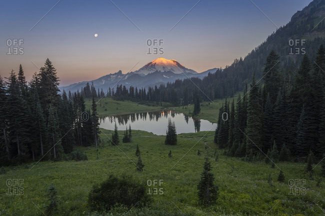 Mount rainier from tipsoo lake at sunrise with moon in the background