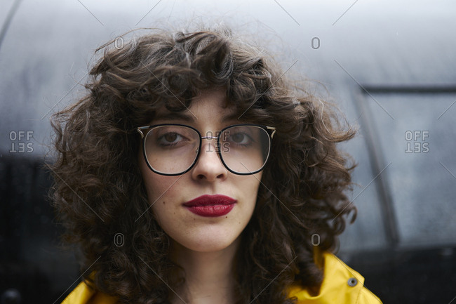 Portrait of curly woman with red lipstick