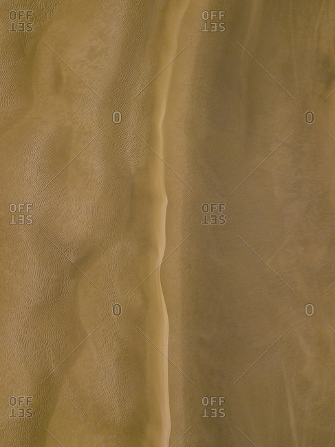 Abstract pattern of sand dunes in cape reinga, new zealand
