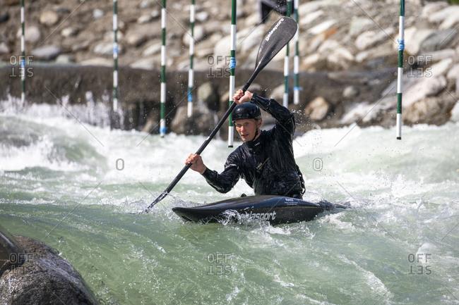 Canada, British Columbia, Pemberton - May 18, 2019: Olympic hopeful kayaker trains at the rutherford whitewater park.