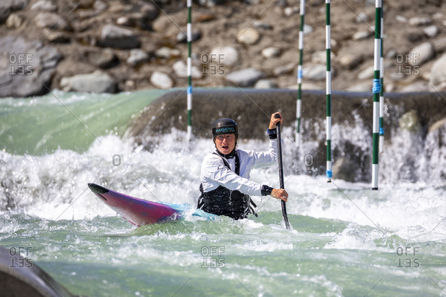 Canada, British Columbia, Pemberton - May 18, 2019: Olympic hopeful kayaker trains at the rutherford whitewater park.