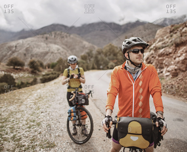 Morocco, Souss-Massa - April 4, 2019: A male and female cyclist take a break on tizi n test pass, morocco