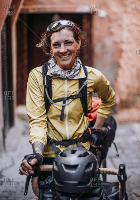 Morocco, Marrakesh-Safi, Marrakesh - April 10, 2019: Female cyclist stands for a portrait in a street in marrakesh, morocco