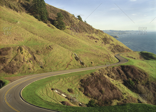 Scenic view of a road winding up a mountain side.