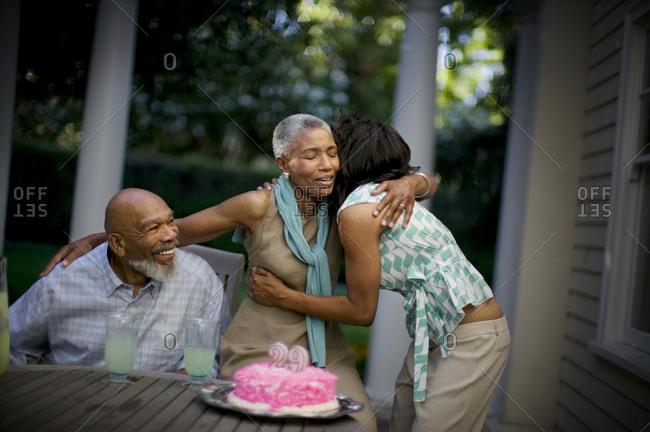 Mature woman hugs her daughter on her wedding anniversary.