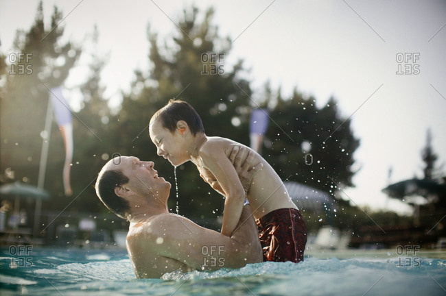 father and son play in pool