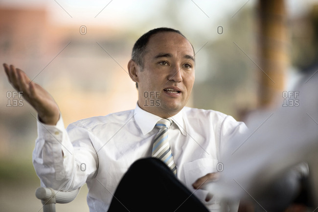 Portrait of a businessman in conversation.
