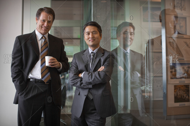 Portrait of two businessmen having a break together in the office.