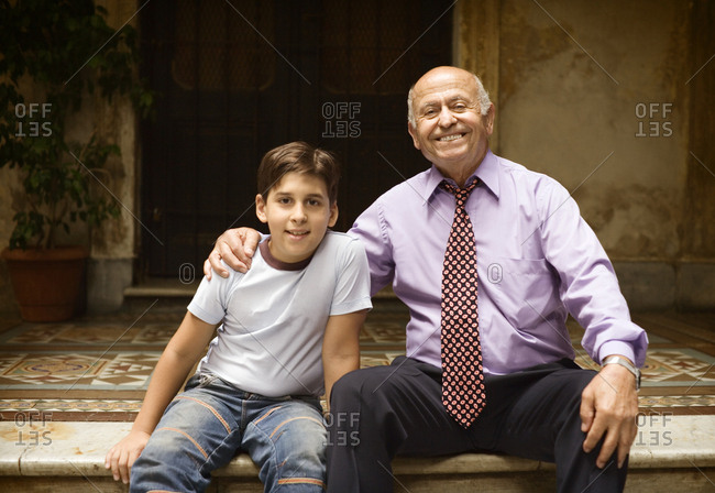 Front view of a cheerful man and a boy.