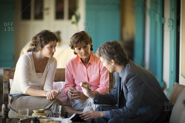 View of three people in a conversation.