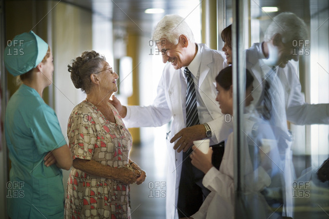 View of a doctor talking to an elderly woman.