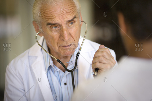 View of a doctor checking up a patient.