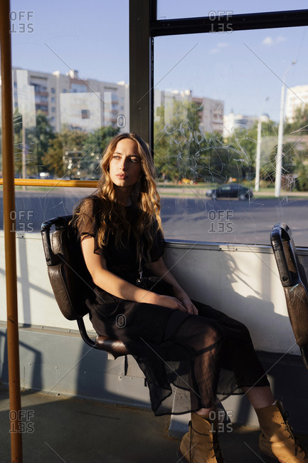 woman sitting in public transport