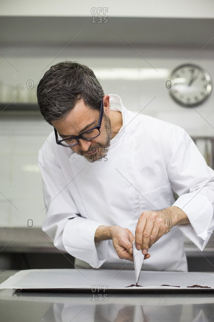 Chef making decorations with pastry bag