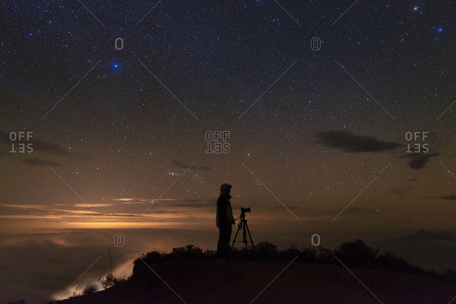 Man photographing the starry sky after sunset