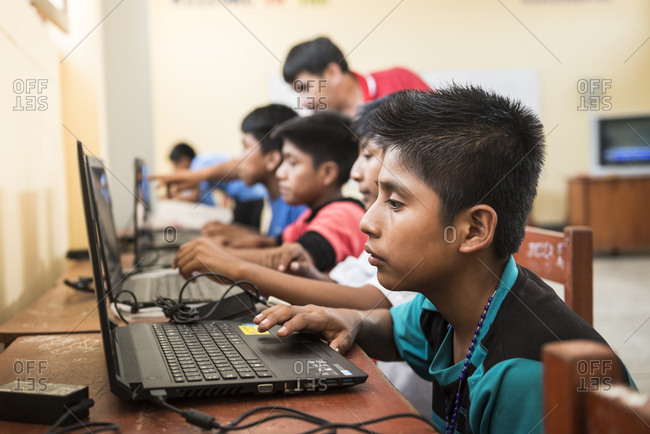 Lambayeque, Peru - June 10, 2015: Peruvian children learning English using computers in a classroom